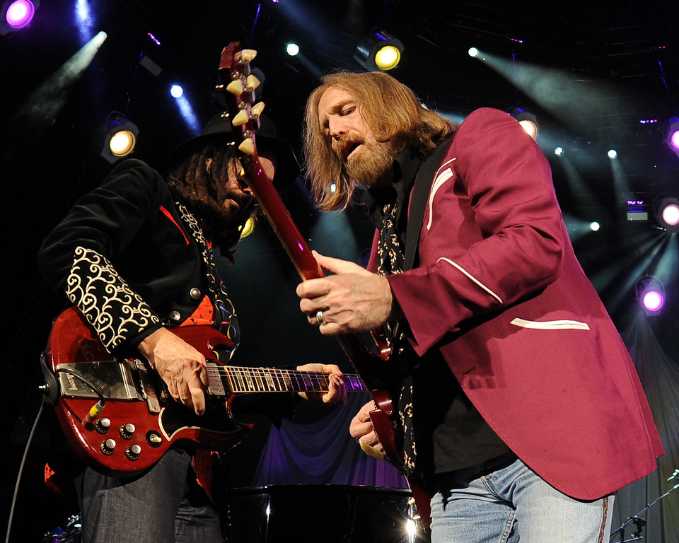 . Mike Cambell and Tom Petty perform during the Tom Petty & the Heartbreakers Tour 2014 at the Cruzan Amphitheater on September 20, 2014 in West Palm Beach, Florida. The band performs June 10 at Quicken Loans Arena. For more information, visit theqarena.com. (Photo by Jeff Daly/Invision/AP)