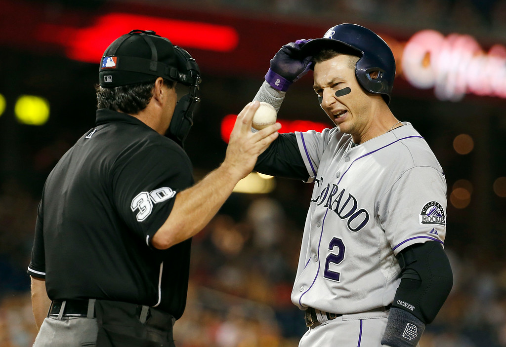 . Colorado Rockies\' Troy Tulowitzki (2) talks with home plate umpire Rob Drake after striking out during the eighth inning of a baseball game against the Washington Nationals at Nationals Park, Wednesday, July 2, 2014, in Washington. The Nationals won 4-3. (AP Photo/Alex Brandon)