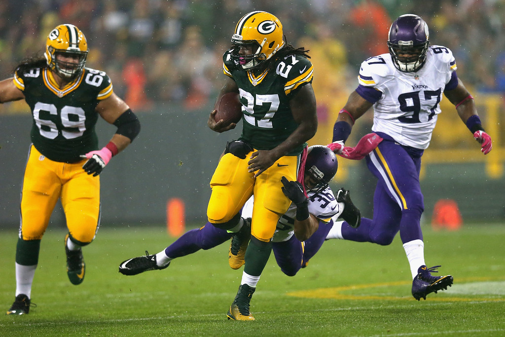 . GREEN BAY, WI - OCTOBER 02:  Robert Blanton #36 of the Minnesota Vikings attempts to take down  Eddie Lacy #27 of the Green Bay Packers at Lambeau Field on October 2, 2014 in Green Bay, Wisconsin. (Photo by Jonathan Daniel/Getty Images)