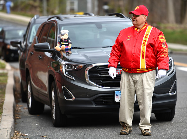 4/8/2020 Mike Orazzi | StaffrU.S. Marine Michael Rinaldi while supporting Bristol Heath workers as they enter and leave Bristol Hospital in Bristol on Wednesday afternoon.