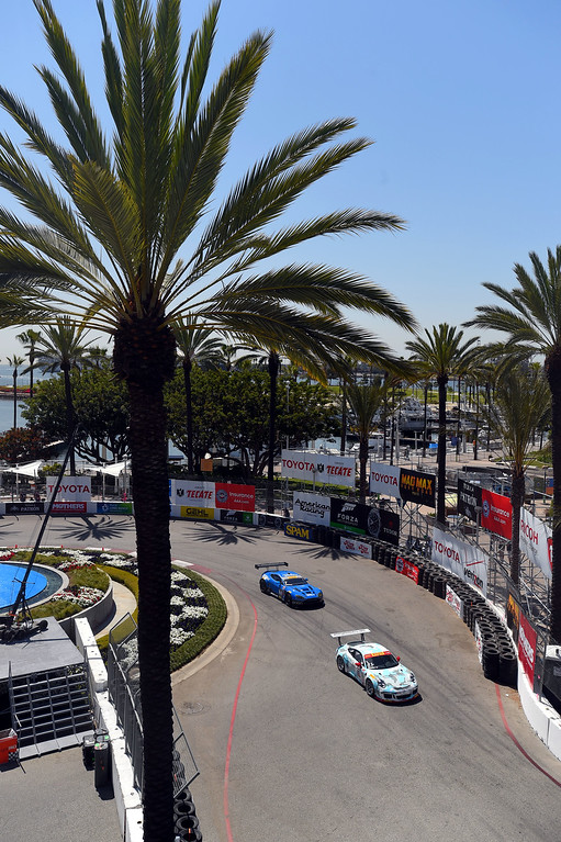 . Pirelli World Cup drivers make the turn around the aquarium fountain in Long Beach, CA on Friday, April 17, 2015. The 40th annual Toyota Grand Prix of Long Beach kicked off with practices for all of the racing divisions. (Photo by Scott Varley, Daily Breeze)