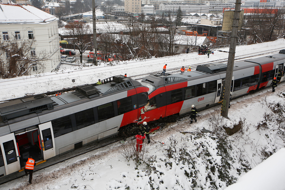 Description of . TOPSHOTS  Firefighters secure the site where two trains of the line S45 stand off rail after having crashed on January 21, 2013 in Vienna, Austria AFP PHOTO / DIETER NAGLDIETER NAGL/AFP/Getty Images