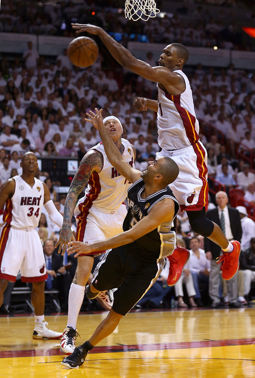 . Tony Parker #9 of the San Antonio Spurs is blocked by Chris Bosh #1 of the Miami Heat in the second half during Game One of the 2013 NBA Finals at AmericanAirlines Arena on June 6, 2013 in Miami, Florida. (Photo by Mike Ehrmann/Getty Images)