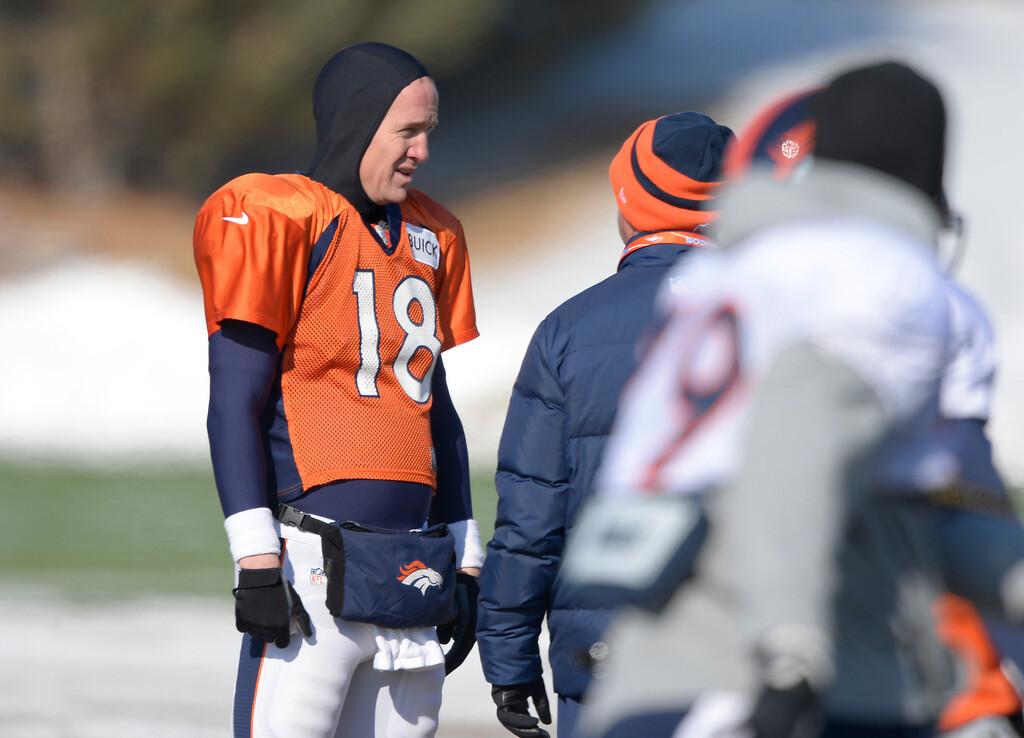 . Denver Broncos quarterback Peyton Manning (18) talks with Denver Broncos head coach John Fox during practice January 23, 2014 at Dove Valley. (Photo by John Leyba/The Denver Post)
