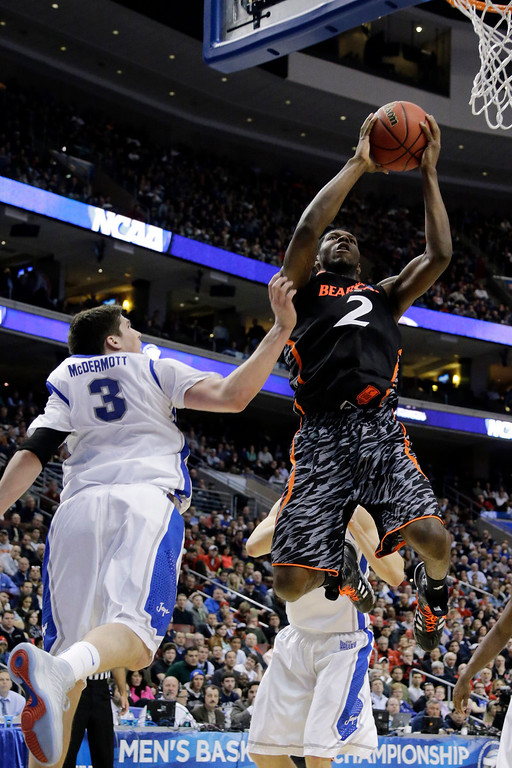 . Cincinnati\'s Titus Rubles, right, goes up for a shot against Creighton\'s Doug McDermott during the first half of a second-round game of the NCAA college basketball tournament, Friday, March 22, 2013, in Philadelphia. (AP Photo/Matt Slocum)
