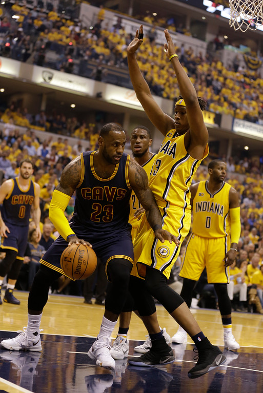 . Cleveland Cavaliers\' LeBron James is defended by Indiana Pacers\' Myles Turner during the first half in Game 3 of a first-round NBA basketball playoff series, Thursday, April 20, 2017, in Indianapolis. (AP Photo/Michael Conroy)