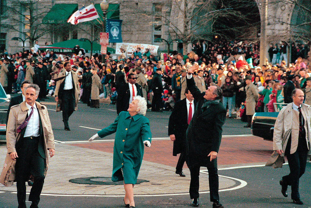 . President George Bush, right, and his wife, first lady Barbara Bush, acknowledge the crowd on Pennsylvania Avenue after getting out of their limousine and walking the inaugural parade route in Washington, D.C., Friday, Jan. 20, 1989. Earlier, Bush was sworn in as the 41st president of the United States. (AP Photo/Dennis Cook)