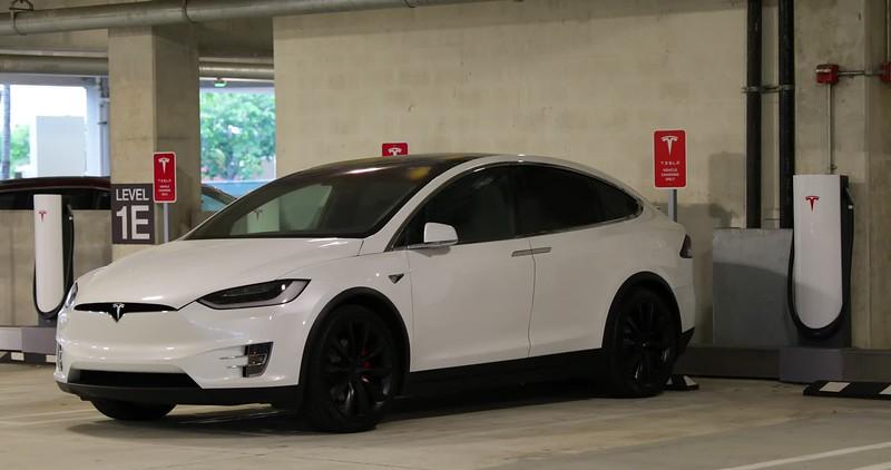 Tesla Model X at a supercharger parking garage