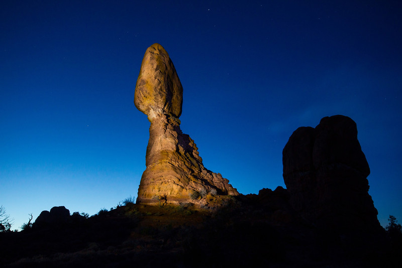 Balanced Rock, a 128 foot high formation was exposed at ISO 800, f11 at 20 seconds with spotlight painting. Taken March 18, 2013 at 6:40 AM in freezing cold. The long exposure makes it look brighter than the pre-dawn glow at the time, which was a very deep blue glow on the far horizon with near black night sky everywhere else.