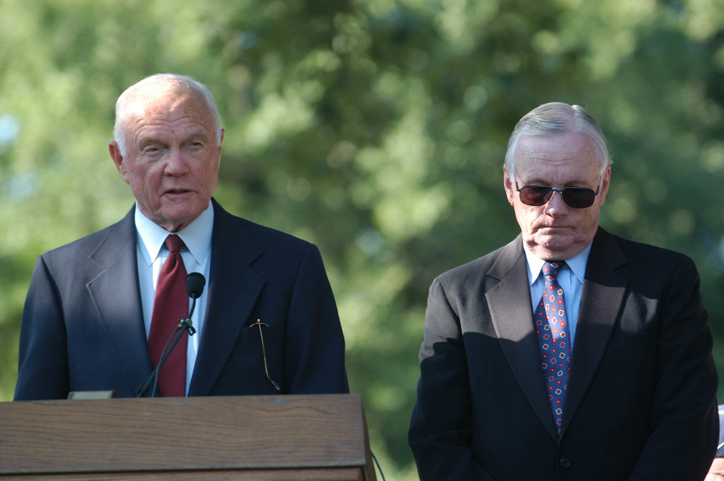 . Former astronaut and senator John Glenn, left, speaks during a memorial service honoring the Wright Brothers in Dayton, Ohio, Saturday, July 19, 2003. At right is former astronaut Neil Armstrong. (AP Photo/David Kohl)