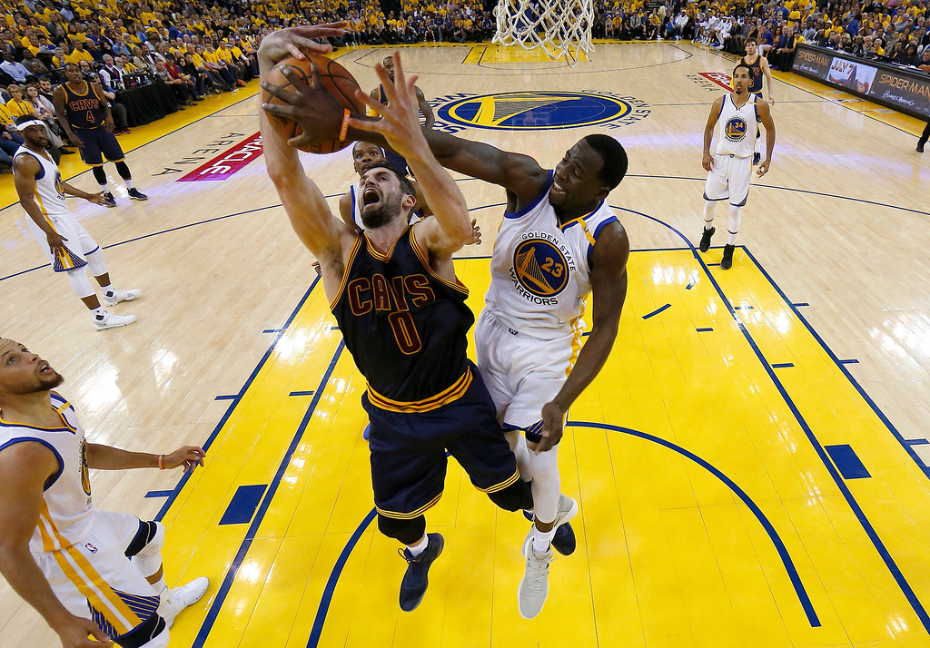 . Golden State Warriors forward Draymond Green (23) defends a shot by Cleveland Cavaliers forward Kevin Love (0) during the first half of Game 1 of basketball\'s NBA Finals in Oakland, Calif., Thursday, June 1, 2017. (AP Photo/Marcio Jose Sanchez, Pool)