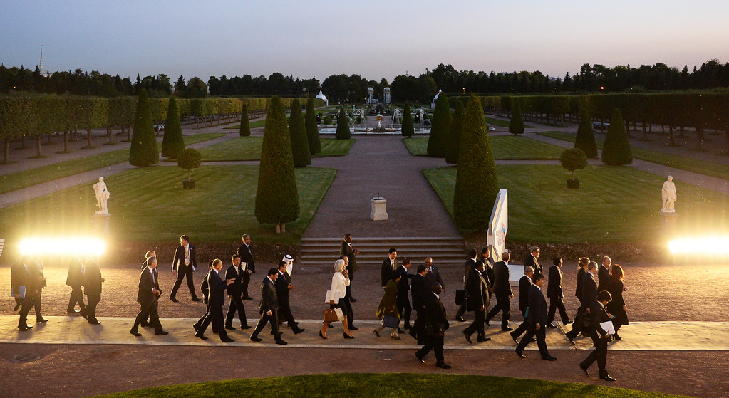 . In this handout image provided by Host Photo Agency, G20 Summit members walk together Ramil Sitdikov after the first day of the G20 Vladimir Astapkovichon September 5, 2013 in St. Petersburg, Russia.    (Photo by Igor Russak /Host Photo Agency via Getty Images)