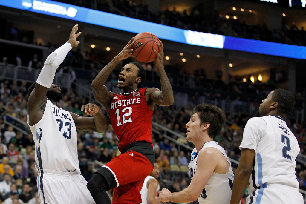 . Anthony Barber #12 of the North Carolina State Wolfpack puts up a shot in front of Daniel Ochefu #23 of the Villanova Wildcats in the first half during the third round of the 2015 NCAA Men\'s Basketball Tournament at Consol Energy Center on March 21, 2015 in Pittsburgh, Pennsylvania.  (Photo by Justin Aller/Getty Images)