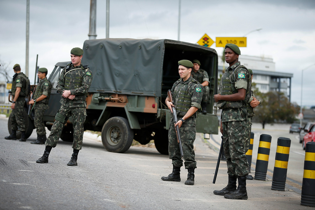 . Brazilian soldiers guard a road leading to Mineirao Stadium in Belo Horizonte, Brazil, Thursday, June, 12, 2014.  (AP Photo/Victor R. Caivano)