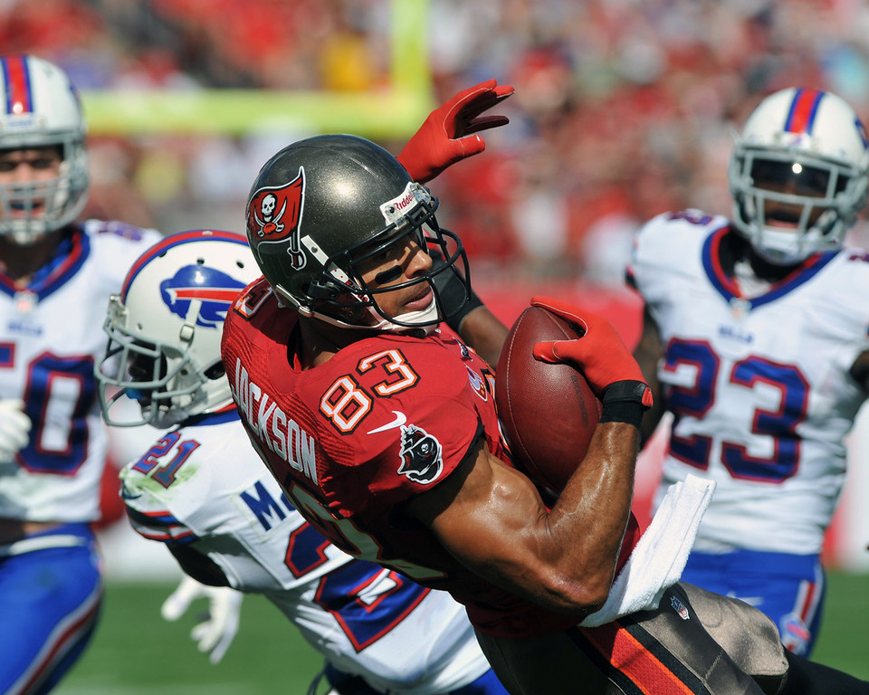 . Wide receiver Vincent Jackson #83 of the Tampa Bay Buccaneers catches a 1st-quarter pass at midfield against the Buffalo Bills   December 8, 2013 at Raymond James Stadium in Tampa, Florida.  (Photo by Al Messerschmidt/Getty Images)