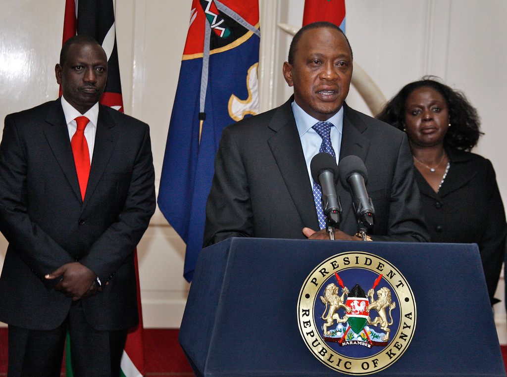 . In this photo released by Kenya\'s Presidency, Kenyan President Uhuru Kenyatta, center, flanked by Deputy President William Ruto, left, and other senior Government and Security officials, makes a television address to the nation from State House in Nairobi, Kenya, Tuesday, Sept. 24, 2013. Kenyatta says security forces have finally defeated a small group of terrorists after four days of fighting at the Nairobi mall. (AP Photo/Kenya Presidency)