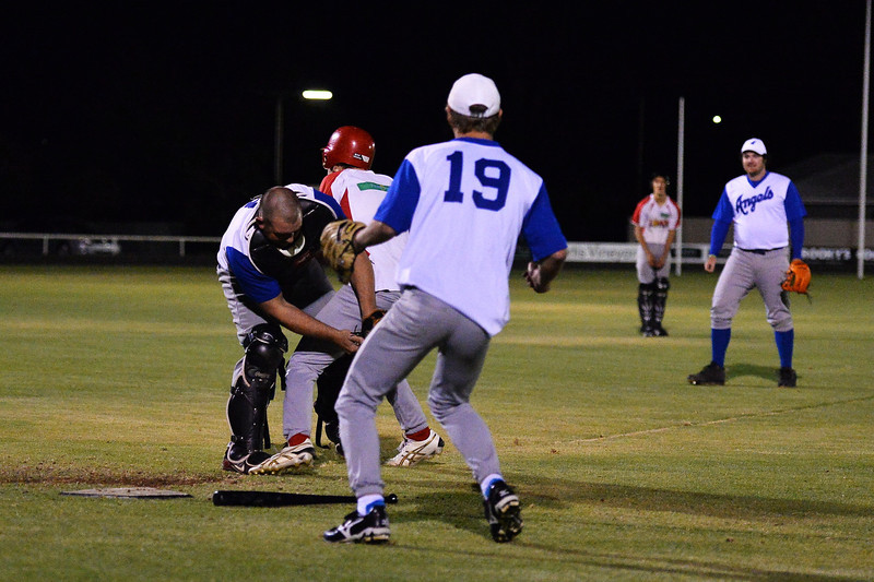 Dave Grenfell (Renmark) clashes with Lyrup player who is trying to steal to home. Dave has the ball.