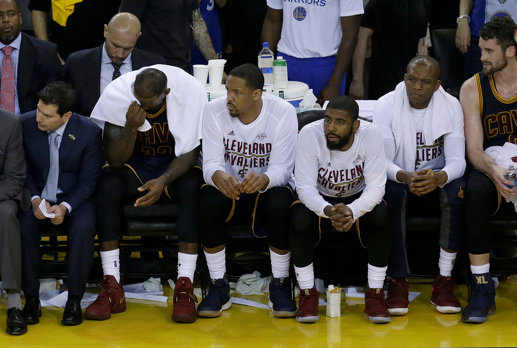 . Cleveland Cavaliers forward LeBron James, second from left, sits on the bench with teammates during the second half of Game 1 of basketball\'s NBA Finals against the Golden State Warriors in Oakland, Calif., Thursday, June 1, 2017. (AP Photo/Ben Margot)
