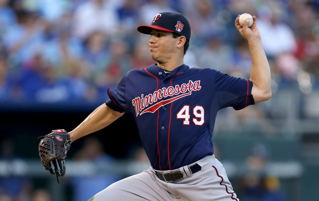 . Twins starter Tommy Milone throws in the first inning against the Royals. (Photo by Ed Zurga/Getty Images)