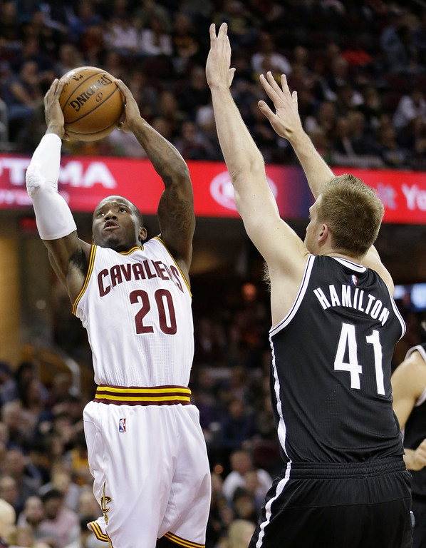 . Cleveland Cavaliers\' Kay Felder (20) drives to the basket against Brooklyn Nets\' Justin Hamilton (41) in the second half of an NBA basketball game, Friday, Dec. 23, 2016, in Cleveland. (AP Photo/Tony Dejak)
