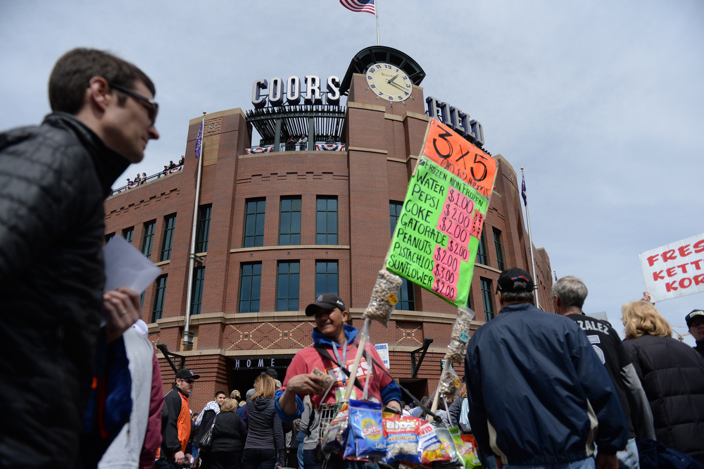 . DENVER, CO. - APRIL 4: Rockies fans head into the stadium before the game. The Colorado Rockies hosted the Arizona Diamondbacks in the Rockies season home opener at Coors Field in Denver, Colorado Friday, April 4, 2014. (Photo by Karl Gehring/The Denver Post)