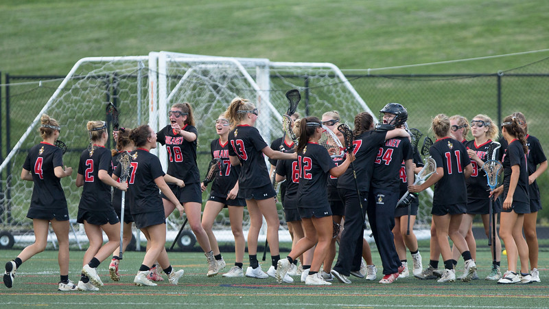 Dulaney High School celebrates their dominating win in the Maryland 4A semi-finals. They will meet Severna Park on May 20. PHOTO BY MIKE CLARK
