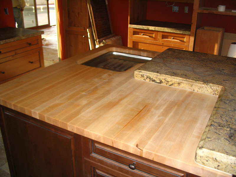 Butcher block top, with the granite overlaying it.