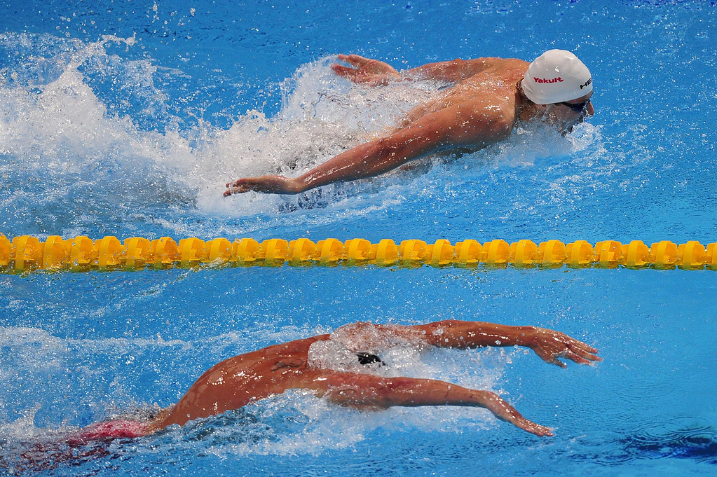 . Russia\'s Evgeny Korotyshkin (top) competes in the final of the men\'s 100-metre butterfly swimming event in the FINA World Championships at Palau Sant Jordi in Barcelona on August 3, 2013. Korotyshkin took third place of the event. JOSEP LAGO/AFP/Getty Images