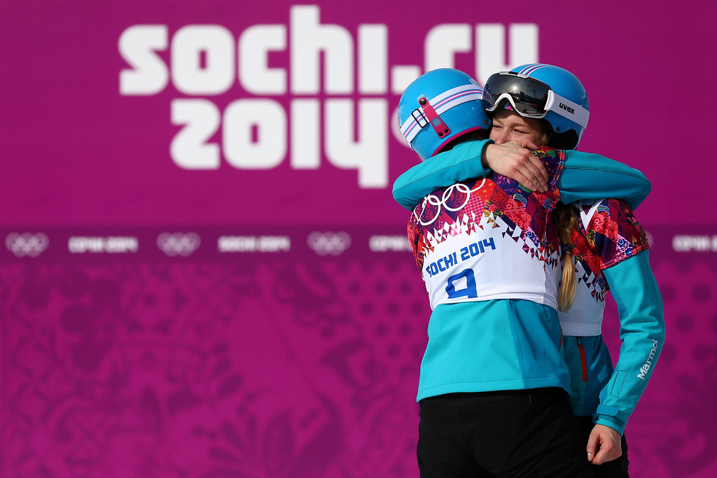 . SOCHI, RUSSIA - FEBRUARY 22:  Silver medalist Anke Karstens (L) and bronze medalist Amelie Kober of Germany celebrate in the Snowboard Ladies\' Parallel Slalom Big Final on day 15 of the 2014 Winter Olympics at Rosa Khutor Extreme Park on February 22, 2014 in Sochi, Russia.  (Photo by Cameron Spencer/Getty Images)