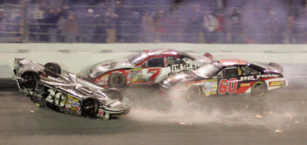 Description of . Clint Bowyer slides upside down on the last lap as Robby Gordon (7) and Boris Said approach during the NASCAR Daytona 500 auto race at Daytona International Speedway in Daytona Beach, Fla., Sunday, Feb. 18, 2007. (AP Photo/Reinhold Matay)