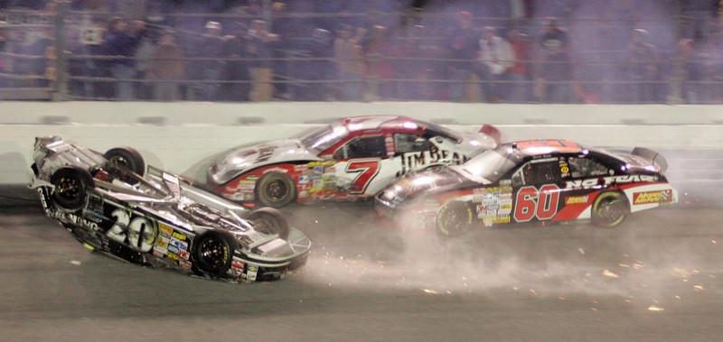 . Clint Bowyer slides upside down on the last lap as Robby Gordon (7) and Boris Said approach during the NASCAR Daytona 500 auto race at Daytona International Speedway in Daytona Beach, Fla., Sunday, Feb. 18, 2007. (AP Photo/Reinhold Matay)