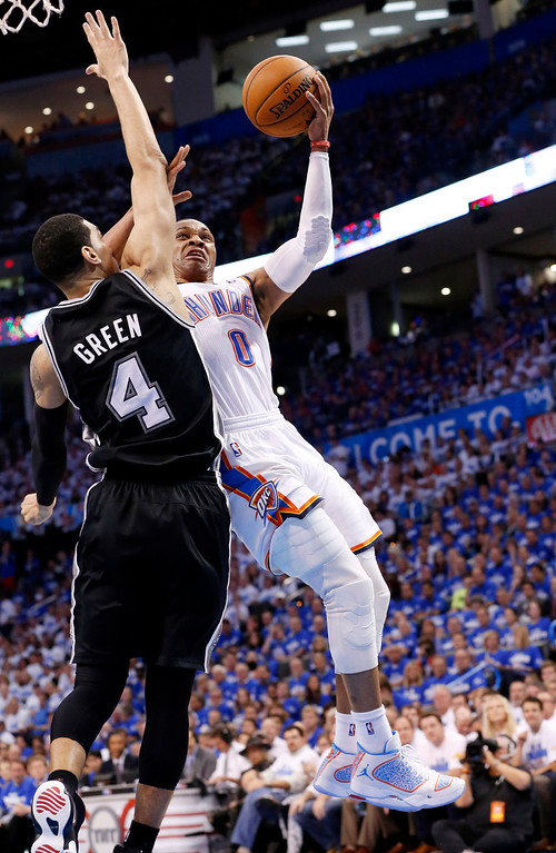 . Oklahoma City Thunder guard Russell Westbrook (0) shoots in front of San Antonio Spurs guard Danny Green (4) in the second quarter of Game 4 of the Western Conference finals NBA basketball playoff series in Oklahoma City, Tuesday, May 27, 2014. (AP Photo/Sue Ogrocki)