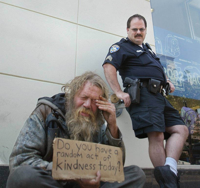 . In this 2002 file photo, Santa Cruz Police Sgt. Loran Baker chats with regular panhandler Chuckie Jensen on Pacific Avenue in Santa Cruz. Baker subsequently asked him to move farther away from the GAP store he was sitting in front of. (Patrick Tehan/Media News file)