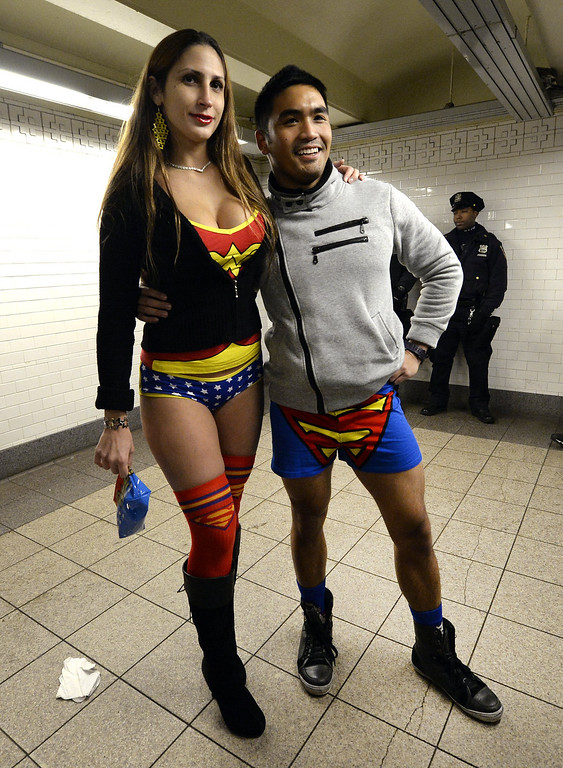 . Two riders in the New York City subway in the underwear as they take part in the 2014 No Pants Subway Ride January 12, 2014.  Started by Improv Everywhere, the goal is for riders to get on the subway train dressed in normal winter clothes without pants and keep a straight face. TIMOTHY A. CLARY/AFP/Getty Images