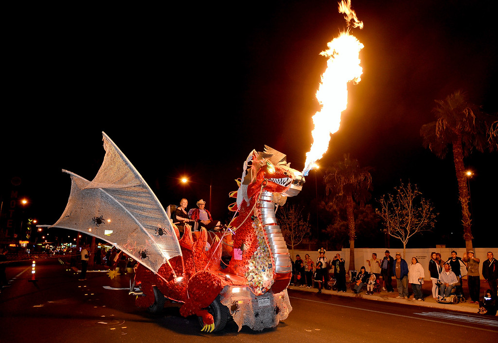. A fire-spewing, dragon-themed float participates in the fourth annual Las Vegas Halloween Parade on October 31, 2013 in Las Vegas, Nevada.  (Photo by Ethan Miller/Getty Images)
