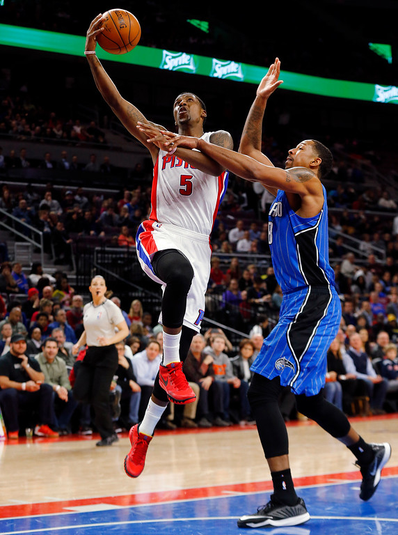 . Detroit Pistons guard Kentavious Caldwell-Pope (5) drives against Orlando Magic forward Channing Frye (8) in the second half of an NBA basketball game in Auburn Hills, Mich., Wednesday, Jan. 21, 2015. (AP Photo/Paul Sancya)