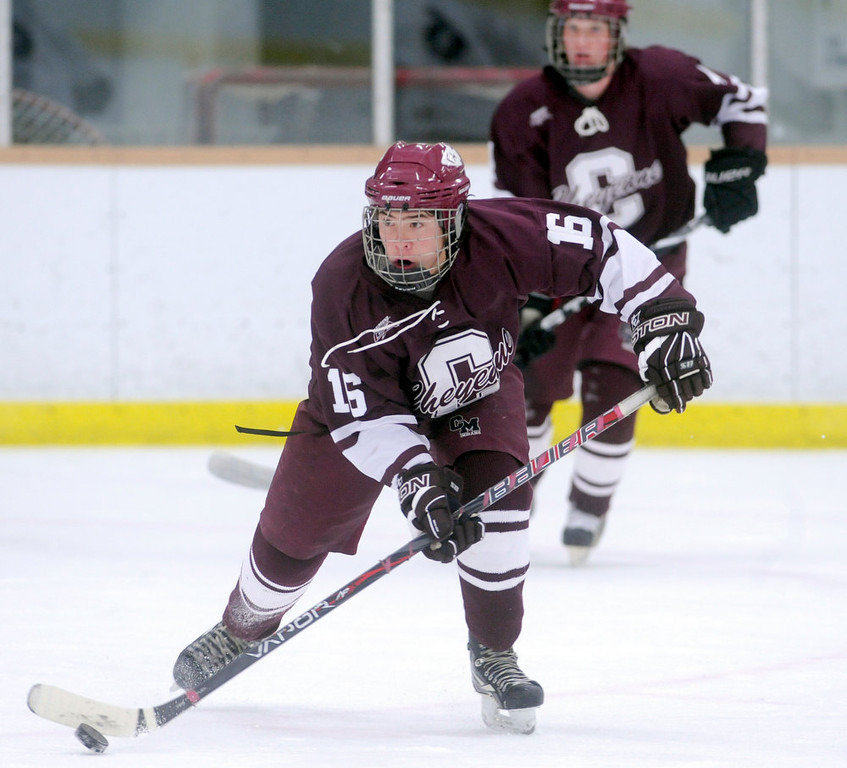 . Cheyenne Mountain\'s Nick McWharter pushes the puck down the ice during the first period of play verses Cherry Creek in 5A High School Hockey action at Family Sports Center in Englewood, CO Saturday December 8, 2012. (Photo by Evan Semon, Special to The Denver Post)