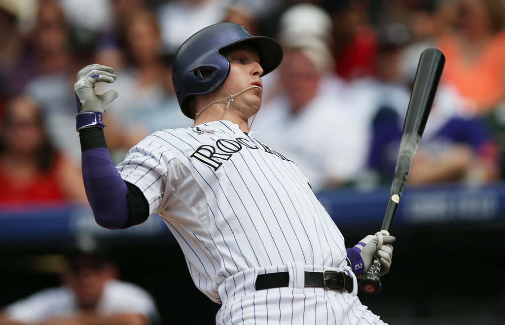 . Colorado Rockies\' Corey Dickerson reels back from inside pitch thrown by Pittsburgh Pirates starter Edinson Volquez in the third inning of a baseball game in Denver, Sunday, July 27, 2014. (AP Photo/David Zalubowski)