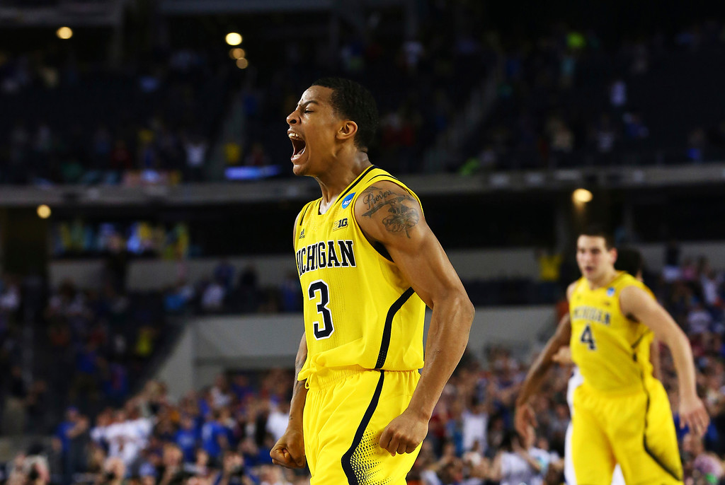 . ARLINGTON, TX - MARCH 29:  Trey Burke #3 of the Michigan Wolverines reacts after shooting a game tying three pointer in the final seconds of the second half againist the Kansas Jayhawks during the South Regional Semifinal round of the 2013 NCAA Men\'s Basketball Tournament at Dallas Cowboys Stadium on March 29, 2013 in Arlington, Texas.  (Photo by Tom Pennington/Getty Images)