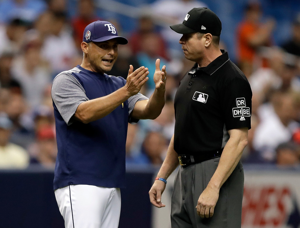 . Tampa Bay Rays manager Kevin Cash, left, argues with third base umpire Carlos Torres after pitcher Vidal Nuno was called for a balk during the eighth inning of a baseball game against the Cleveland Indians Tuesday, Sept. 11, 2018, in St. Petersburg, Fla. Cash was ejected. (AP Photo/Chris O\'Meara)