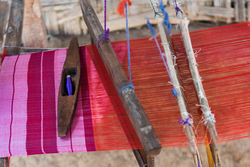 Close-up of fabric weaving on loom, Laos
