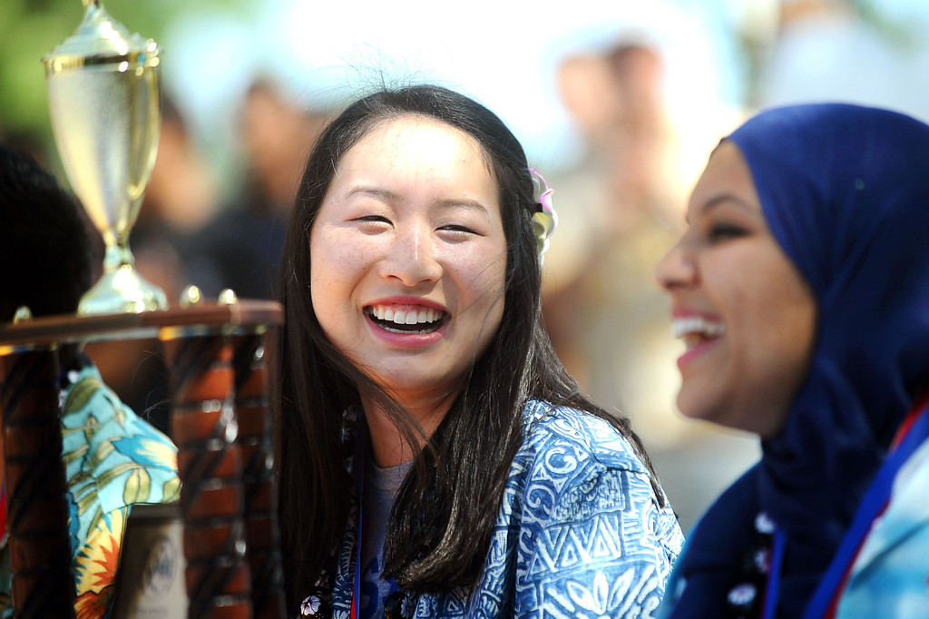 . Melissa Cheng and Neelem Sheikh (l-r) share a smile during a rally for El Camino Real Charter High School\'s Academic Decathlon team who won its seventh national title last week in Honolulu, Hawaii.(Andy Holzman/Los Angeles Daily News)