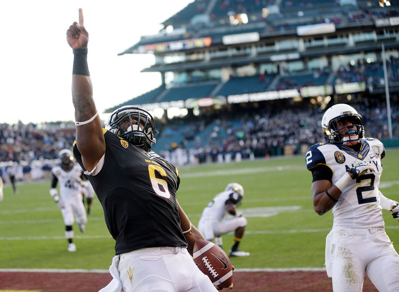 . Arizona State running back Cameron Marshall (6) celebrates his a 33-yard touchdown run near Navy cornerback Parrish Gaines (2) during the second half of the Fight Hunger Bowl NCAA college football game in San Francisco, Saturday, Dec. 29, 2012. (AP Photo/Marcio Jose Sanchez)