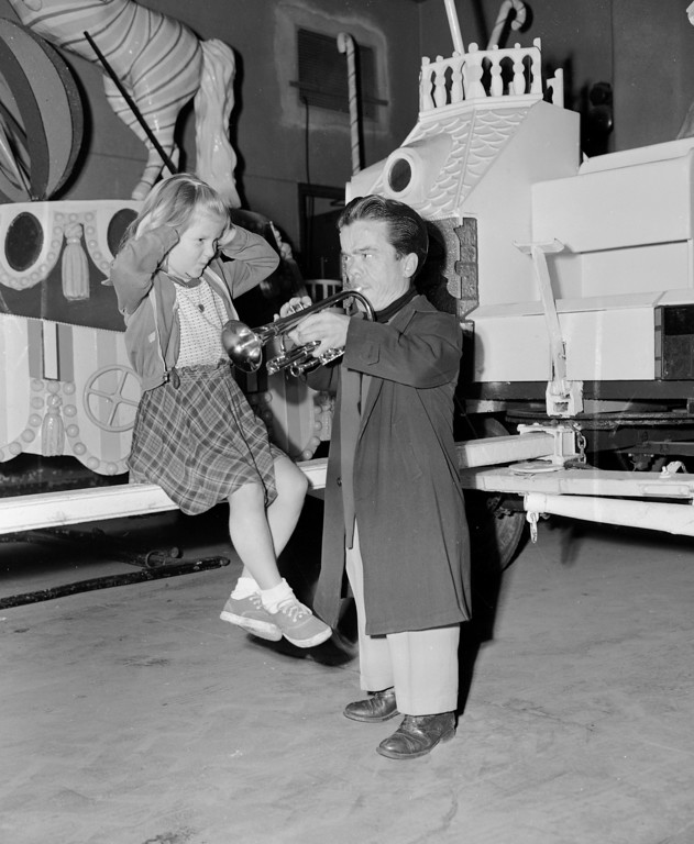 . John Armstrong, one of the clowns of the Ringling Bros. and Barnum & Bailey Circus, plays for IIona Fredoni of Berlin, Germany, during a moment of backstage banter at Madison Square Garden, New York, April 14, 1953. Iiona, is the daughter of members of one of the circus troupes. (AP Photo)