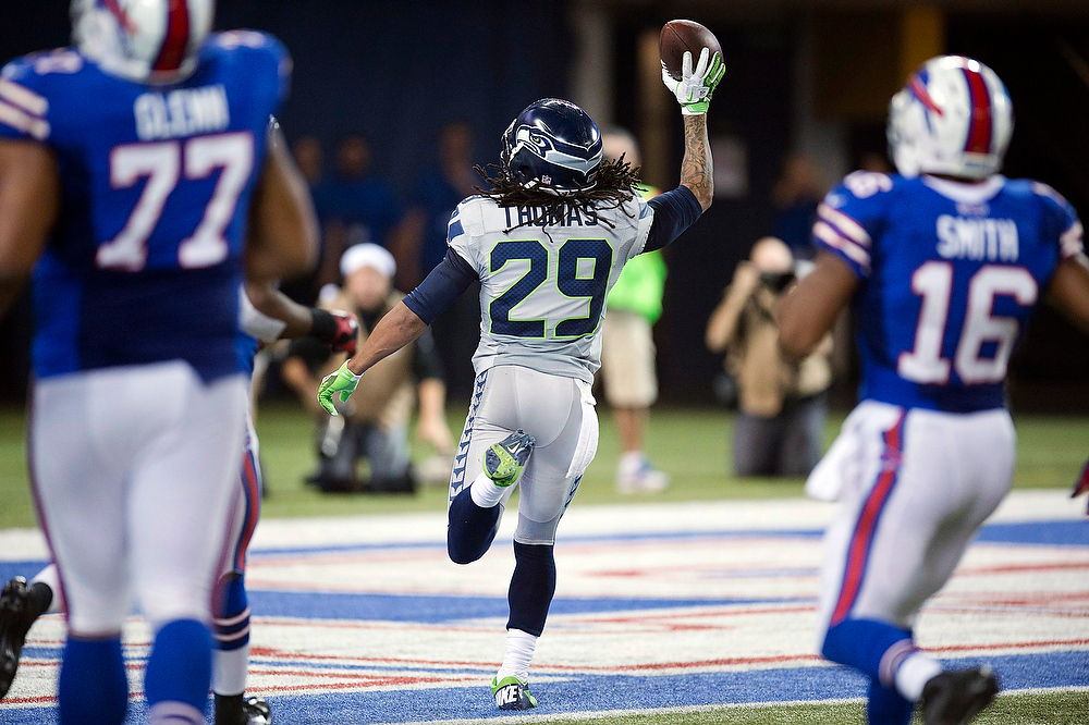 . Seattle Seahawks safety Earl Thomas celebrates as he returns an interception for a touchdown against the Buffalo Bills during the second half of an NFL football game, Sunday, Dec. 16, 2012, in Toronto. The Seahawks won 50-17. (AP Photo/The Canadian Press, Frank Gunn)