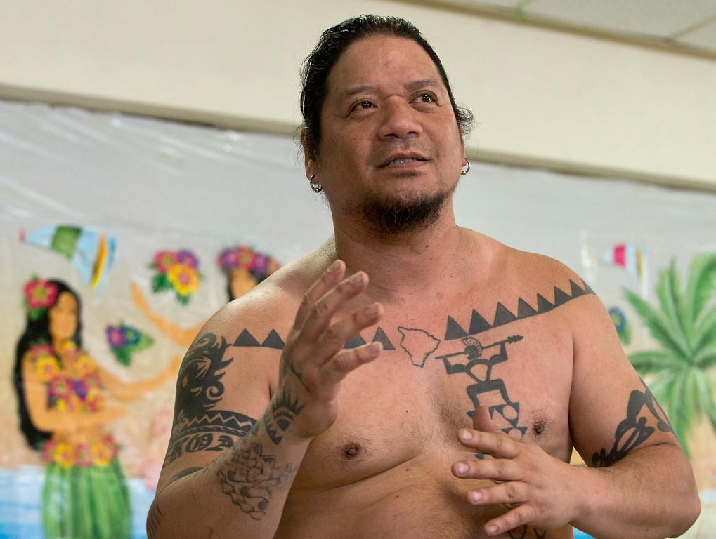 . Duncan Scott/DScott@News-Herald.com Ku\'u Awai explains the meaning of the Hawaiian greeting Aloha during a luau on June 18 at the Lake County Board of Developmental Disabilities/Deepwood Vocational Guidance Center.