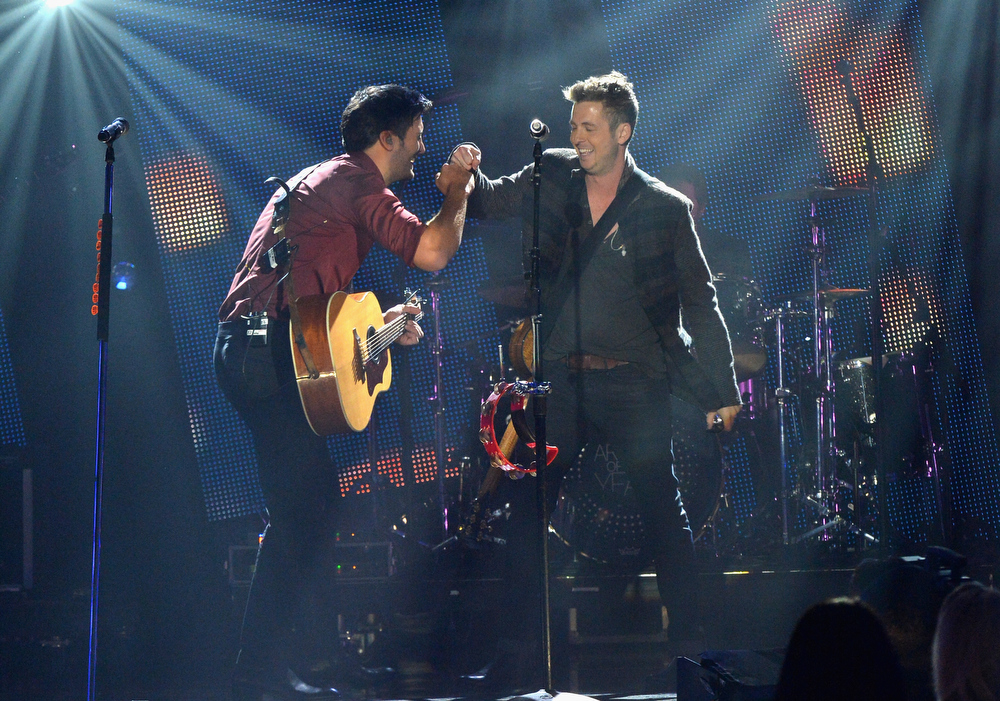 Description of . Luke Bryan and Ryan Tedder perform onstage during the 2012 CMT Artists Of The Year at The Factory at Franklin on December 3, 2012 in Franklin, Tennessee.  (Photo by Rick Diamond/Getty Images for CMT)