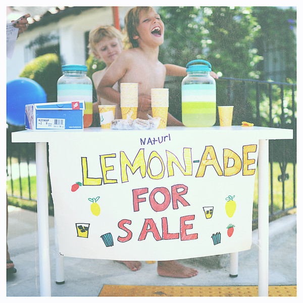 A beach lemonade stand that some kids in the neighborhood put up right across the street to make some money - and they did.