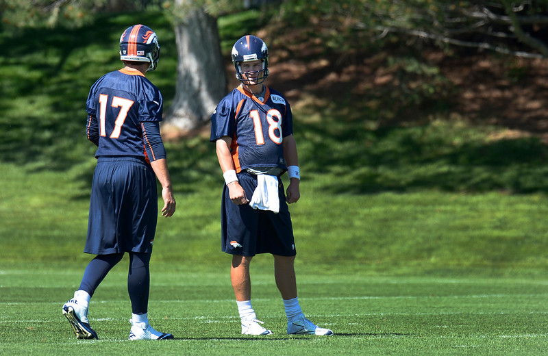 . Quarterback Peyton Manning (18) of the Denver Broncos talks  with QB Brock Osweiler (17) during OTAs June 6, 2013 at Dove Valley. (Photo By John Leyba/The Denver Post)