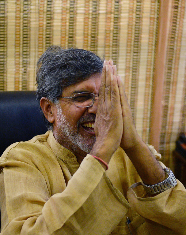 . Indian activist Kailash Satyarthi gestures to journalists at this home office after the announcement of him receiving the Nobel Peace Prize, in New Delhi on October 10, 2014. Indian activist Kailash Satyarthi said October 10 his Nobel Peace Prize would help highlight the plight of children around the world, and invited fellow winner Malala Yousafzai to work with him. AFP PHOTO / CHANDAN  Khanna/AFP/Getty Images